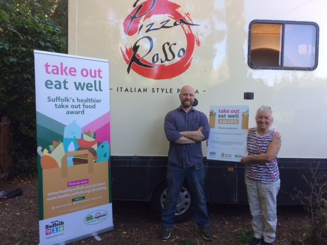 Pizza Rosso mobile pizza van receiving a take out eat well award