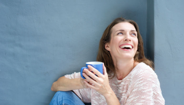 Woman sitting with mug