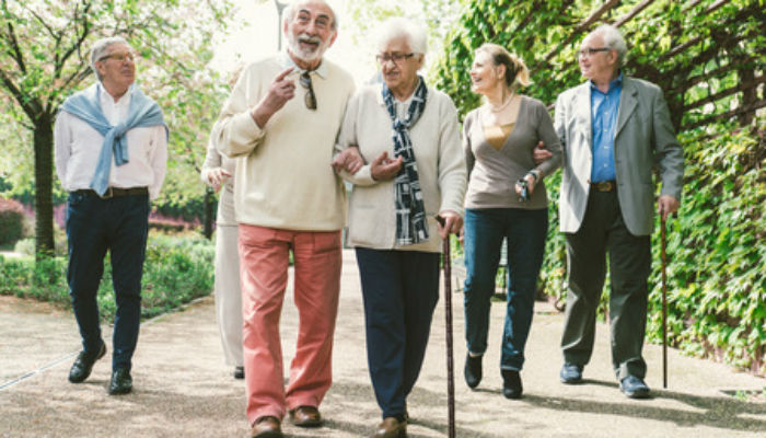 Five older people walking