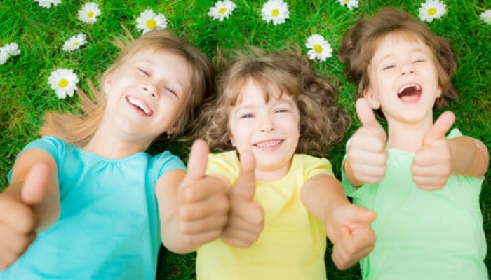 Three child giving thumbs up